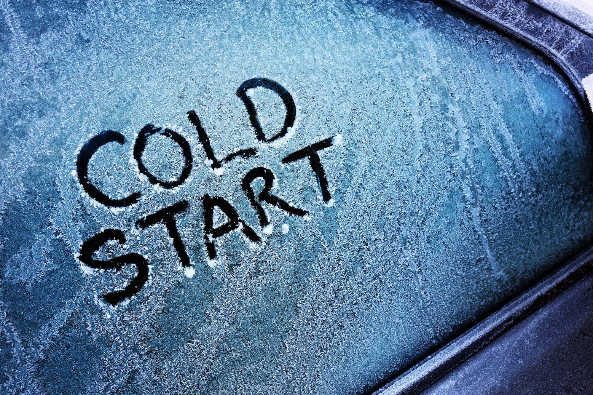 'Cold Start' written on a frosted car window.